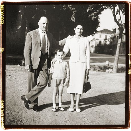 Somewhere with my parents. My family didn't own a camera, had to loan it from a better-doing uncle
