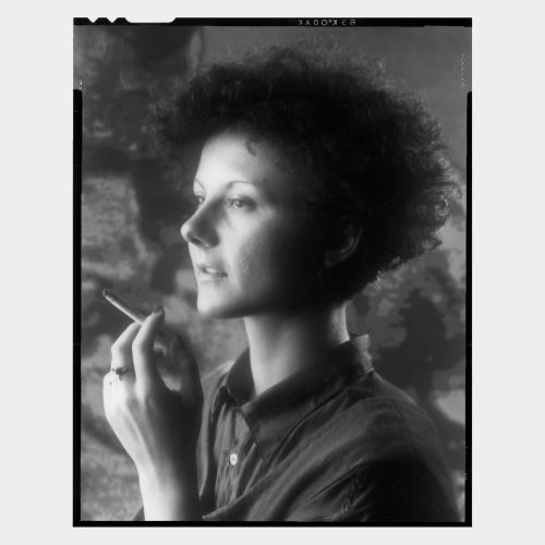 Young woman with curly hair and cigarette